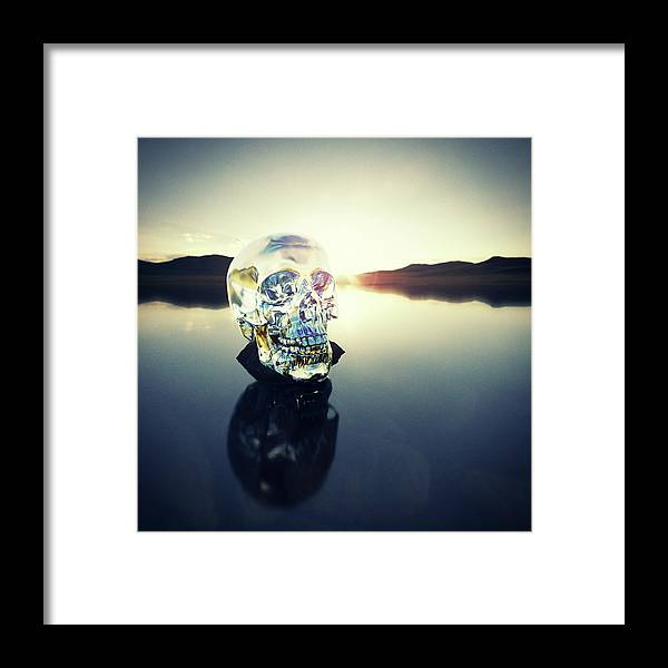 Art Framed Print featuring the photograph Crystal Skull Laying On Rock In Lake by Doug Armand