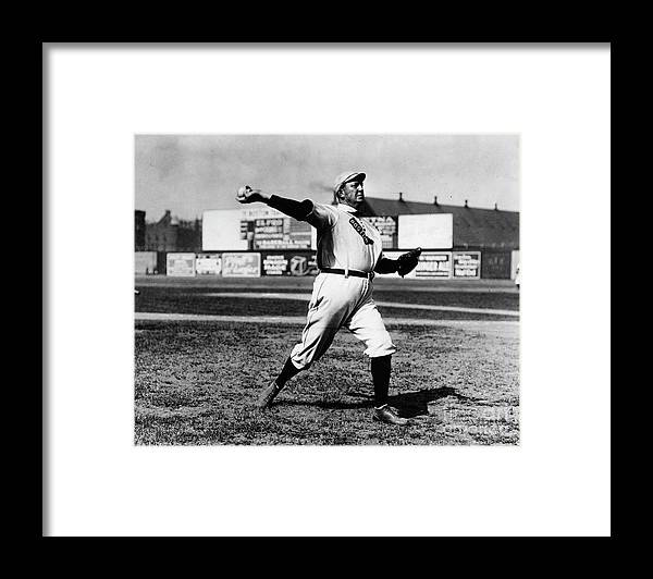 People Framed Print featuring the photograph Cy Young Boston Wind Up by Transcendental Graphics
