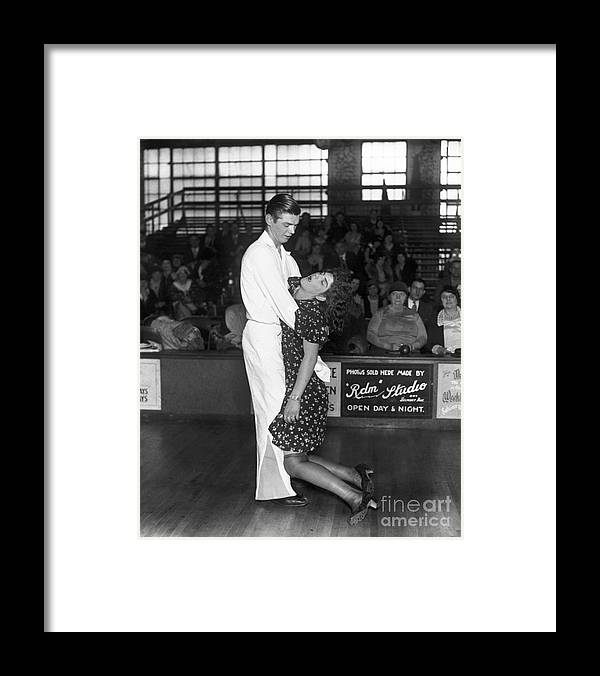 People Framed Print featuring the photograph Dancer Holding His Exhausted Partner by Bettmann