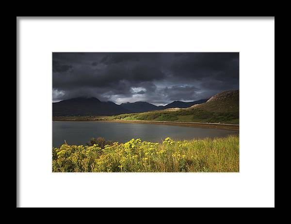 Tranquility Framed Print featuring the photograph Dark Storm Clouds Hang Over The by John Short / Design Pics