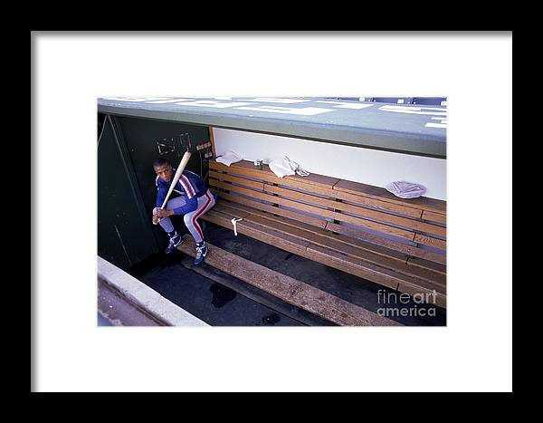 People Framed Print featuring the photograph Darryl Strawberry Sits In The Dugout by Jonathan Daniel