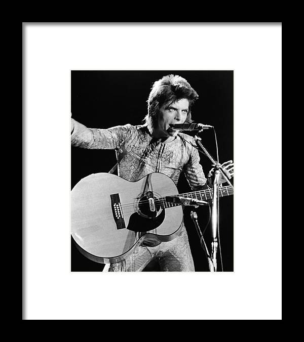 Rock Music Framed Print featuring the photograph David Bowie Performing As Ziggy Stardust by Hulton Archive