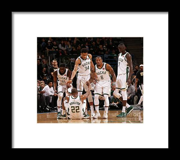 Assistance Framed Print featuring the photograph Denver Nuggets V Milwaukee Bucks by Nba Photos