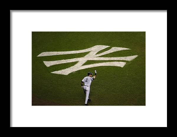 Game Two Framed Print featuring the photograph Derek Jeter Walks To The Plate by Jed Jacobsohn
