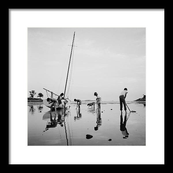 Leverett Saltonstall Framed Print featuring the photograph Digging For Clams by Slim Aarons