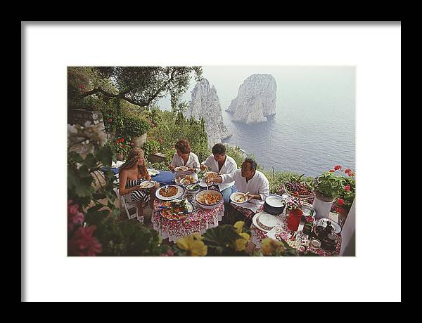 Artist Framed Print featuring the photograph Dining Al Fresco On Capri by Slim Aarons