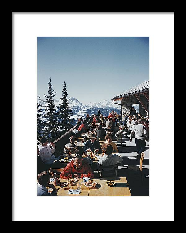 Gstaad Framed Print featuring the photograph Dining In Gstaad by Slim Aarons