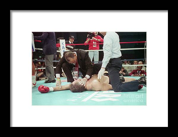 People Framed Print featuring the photograph Doctor Checks Gerry Cooney Who Is Kod by Bettmann