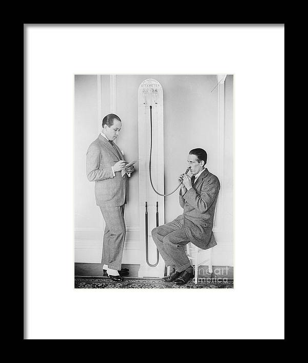 People Framed Print featuring the photograph Doctor Treating Patient With Vitameter by Bettmann