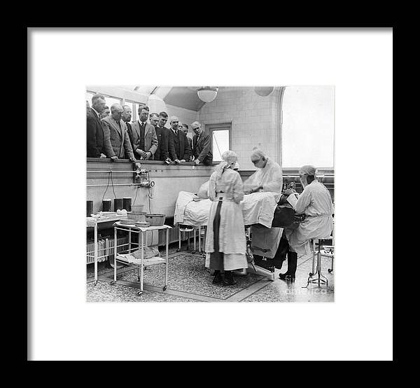 People Framed Print featuring the photograph Doctors Watching Surgery In Tottenham by Bettmann
