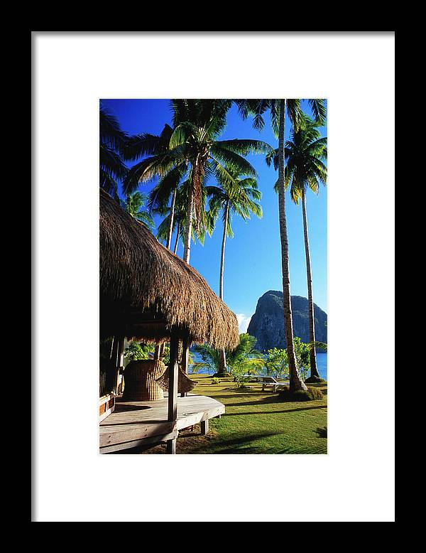 Tropical Tree Framed Print featuring the photograph Dolarog Beach Resort With Inabuyatan by Dallas Stribley