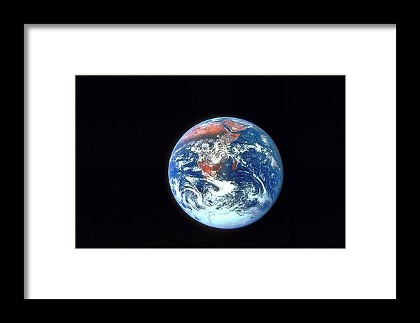 Globe Framed Print featuring the photograph Earth From Outer Space by Ablestock.com