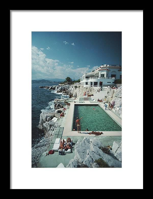 Recreational Pursuit Framed Print featuring the photograph Eden-roc Pool by Slim Aarons
