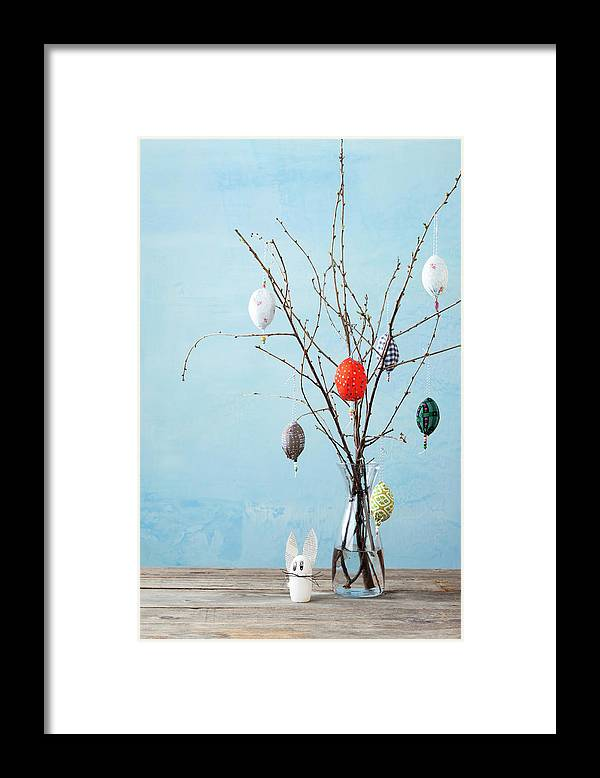 Holiday Framed Print featuring the photograph Egg-shaped Decorations On Branches by Stefanie Grewel