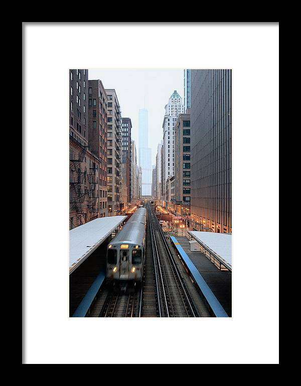 Downtown District Framed Print featuring the photograph Elevated Commuter Train In Chicago Loop by Photo By John Crouch