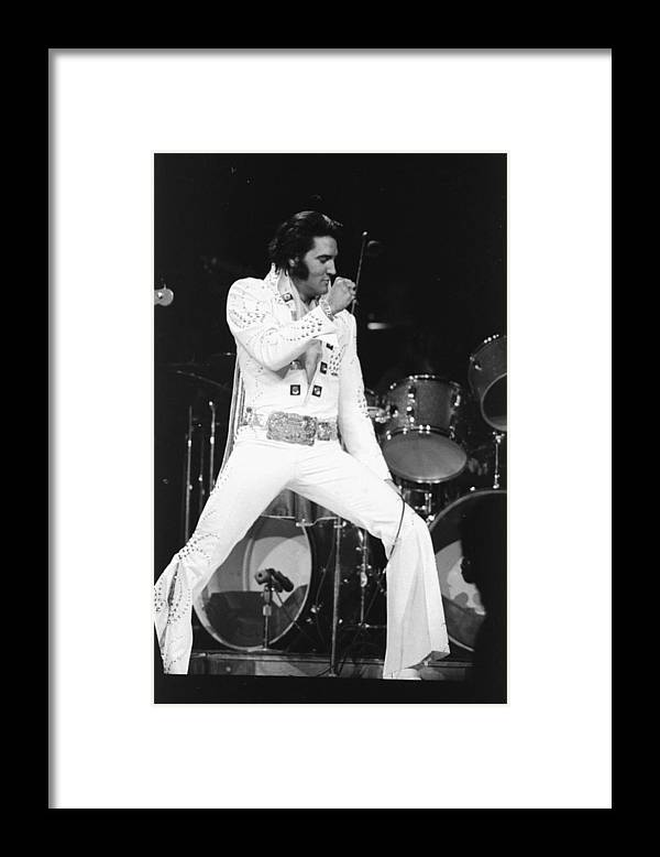 Elvis Presley Framed Print featuring the photograph Elvis Presley On Stage During His 1972 by New York Daily News Archive