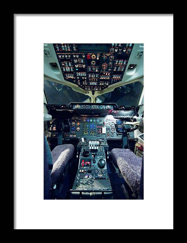 Cockpit Framed Print featuring the photograph Empty Aeroplane Cockpit by Moodboard