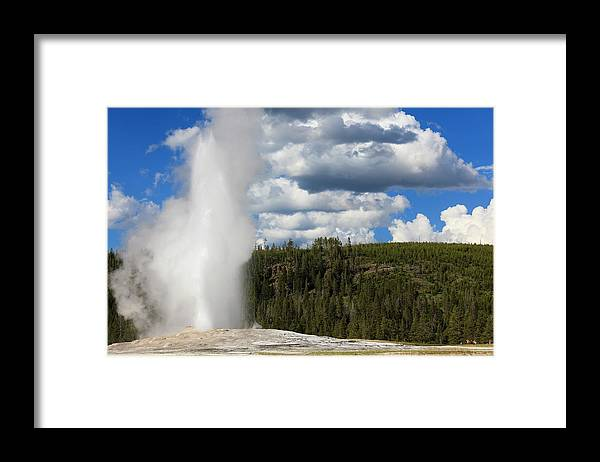 Geyser Framed Print featuring the photograph Eruption Of Old Faithful Geyser In by Pawel.gaul