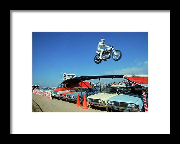 Timeincown Framed Print featuring the photograph Evel Knievel In Flight by Ralph Crane