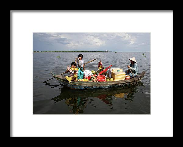 Child Framed Print featuring the photograph Family & Snake Sell Wares On Tonle by Rosemary Calvert