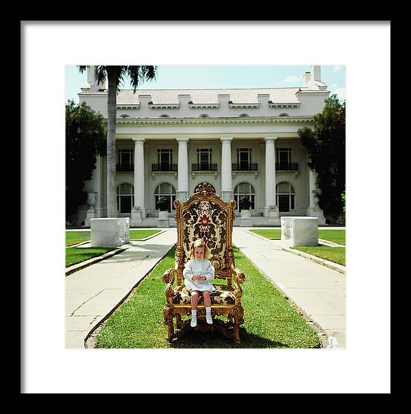 Child Framed Print featuring the photograph Family Chair by Slim Aarons