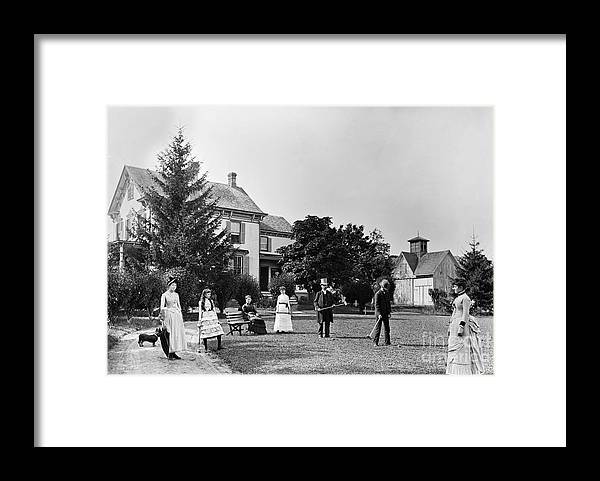 People Framed Print featuring the photograph Family Plays Croquet In Front Of Home by Bettmann
