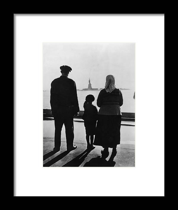 People Framed Print featuring the photograph Family Views Statue Of Liberty From by Fpg