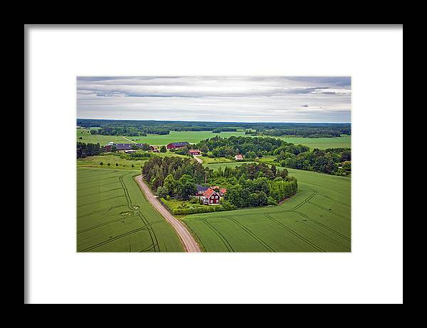 Scenics Framed Print featuring the photograph Farms And Fields In Sweden North Europe by Pavliha
