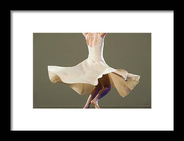 Ballet Dancer Framed Print featuring the photograph Female Ballet Dancer Dancing by Erik Isakson