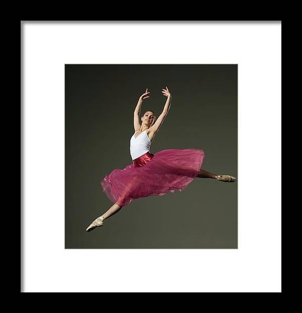 Ballet Dancer Framed Print featuring the photograph Female Ballet Dancer Jumping by Tetra Images - Erik Isakson
