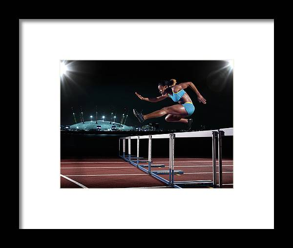 People Framed Print featuring the photograph Female Hurdling In London by Mike Harrington