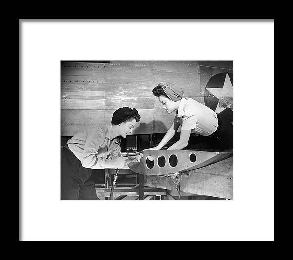 Working Framed Print featuring the photograph Female Workers Working On Plane by George Marks