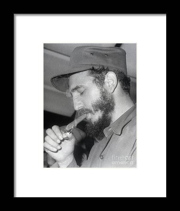 Smoking Framed Print featuring the photograph Fidel Castro Lighting A Cigar by Bettmann