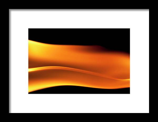 Orange Color Framed Print featuring the photograph Fire Burning, Flames On Black Background by Tttuna