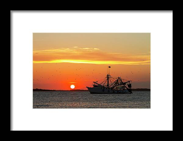 Water's Edge Framed Print featuring the photograph Fishing Boat At Sunset by Tshortell