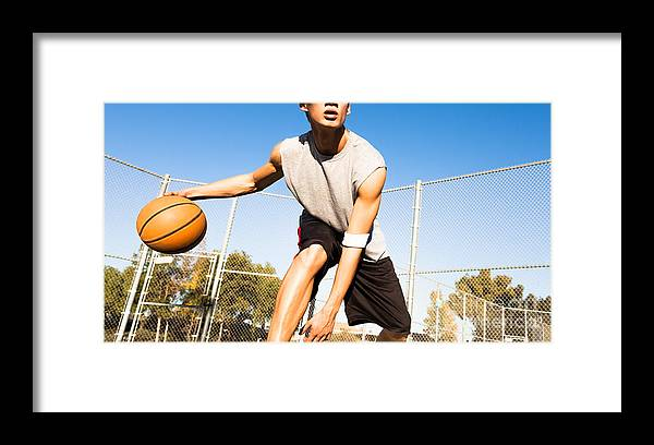 College Framed Print featuring the photograph Fit Male Playing Basketball Outdoor by Pkpix