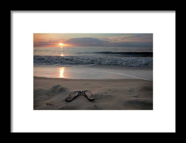 Water's Edge Framed Print featuring the photograph Flip-flops On The Beach by Sdominick