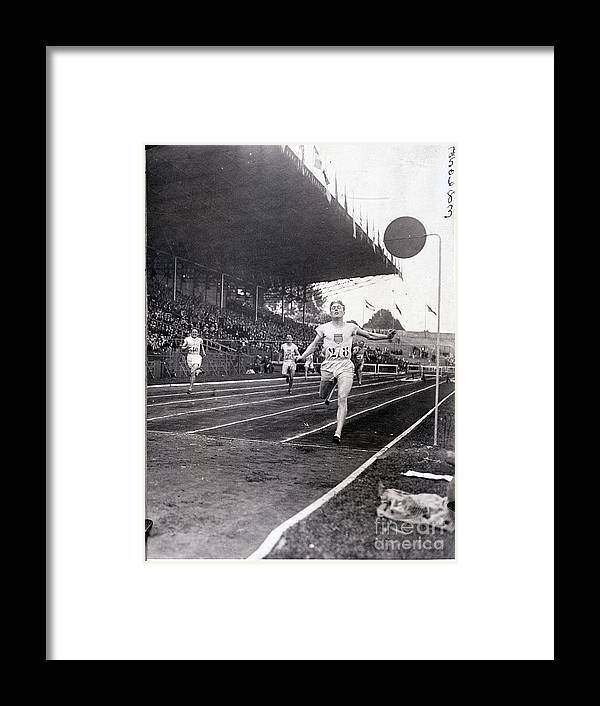 The Olympic Games Framed Print featuring the photograph F.m. Taylor Wins 400 Meter Olympic by Bettmann
