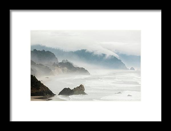 Scenics Framed Print featuring the photograph Fog Shrouded View Of Rocky Coastline by Win-initiative