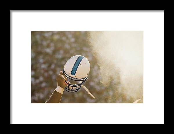 Celebration Framed Print featuring the photograph Football Player Waving Helmet In Air by David Madison