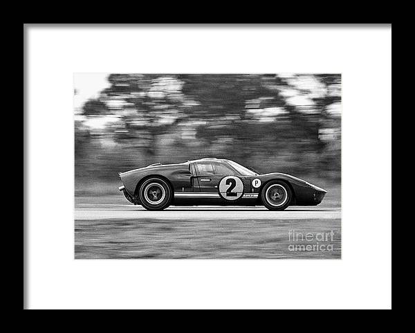 People Framed Print featuring the photograph Ford Prototype Racecar On Track by Bettmann