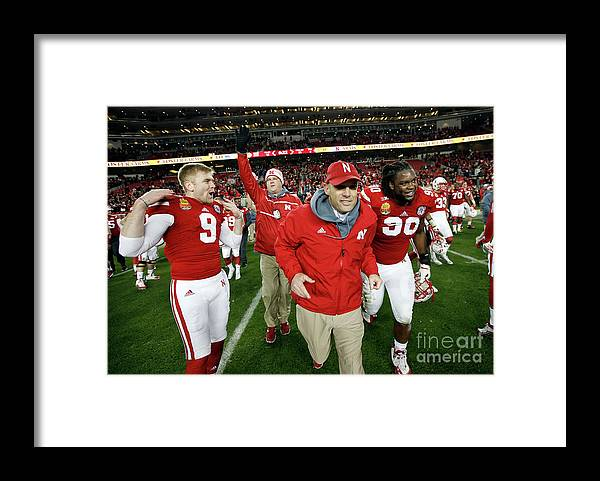 Levi's Framed Print featuring the photograph Foster Farms Bowl - Nebraska V Ucla by Ezra Shaw