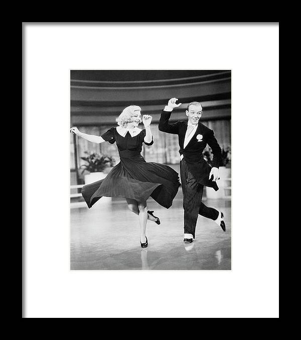Fred Astaire And Ginger Rogers Dancing Framed Print By Bettmann