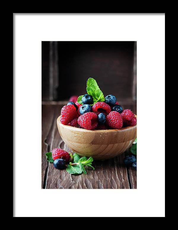 Vitamin Framed Print featuring the photograph Fresh Sweet Raspberry And Bluberry by Oxana Denezhkina