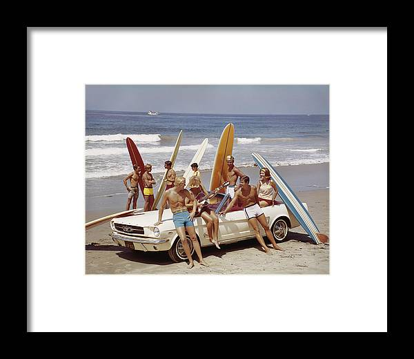 Young Men Framed Print featuring the photograph Friends Having Fun On Beach by Tom Kelley Archive