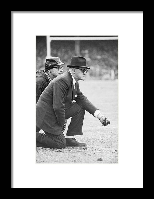 Fist Framed Print featuring the photograph George Halas Kneeling On Sidelines by Bettmann