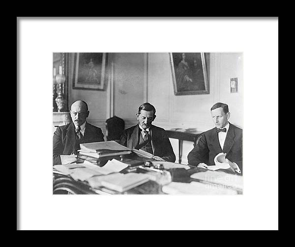 Versailles Framed Print featuring the photograph German Envoy Going Over Documents by Bettmann