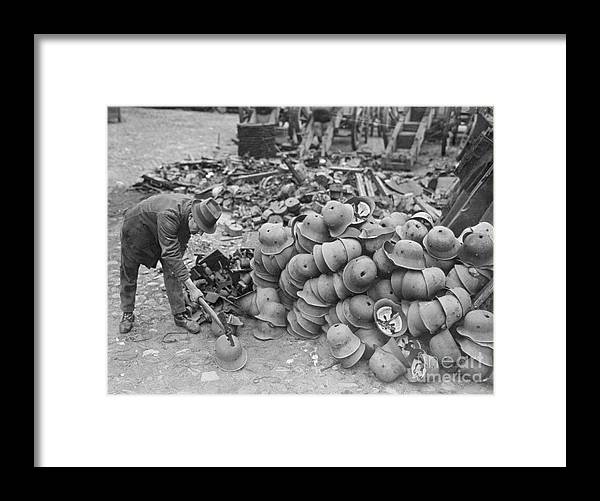 Versailles Framed Print featuring the photograph German Helmets Stacked For Elimination by Bettmann