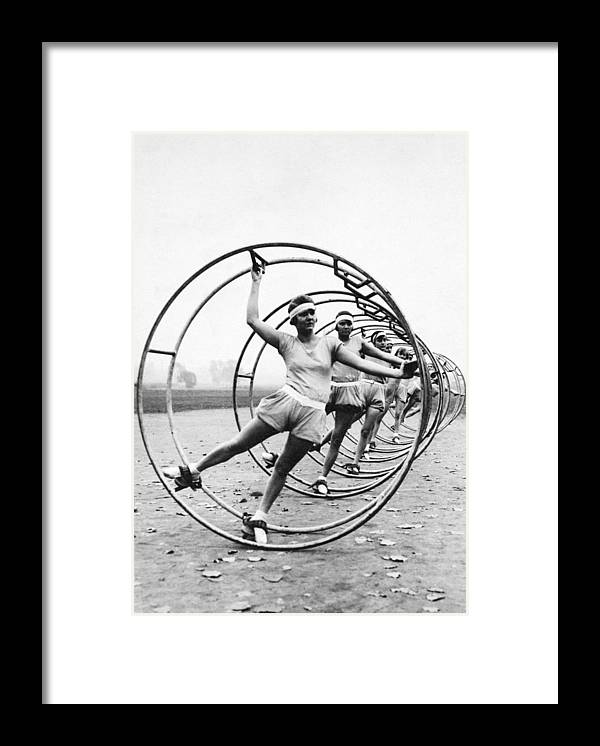 Contest Framed Print featuring the photograph German Women Practicing Rhonrad For A by New York Daily News Archive