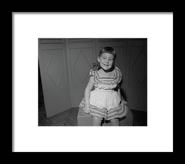 Three Quarter Length Framed Print featuring the photograph Girl 6-7 Sitting On Box, Smiling by George Marks